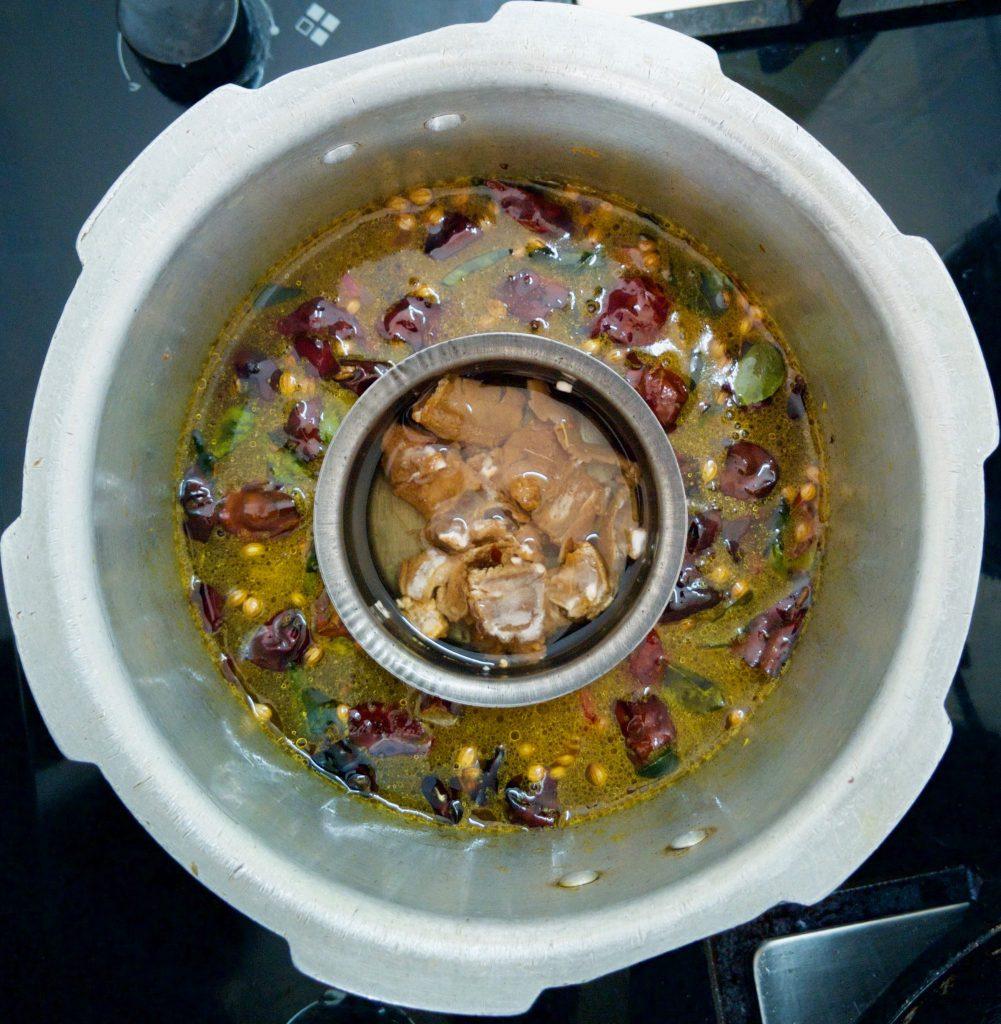 adding water to menthi papu